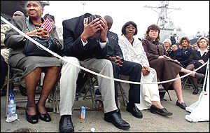 Mourners at Wednesday's memorial service for the dead US sailors