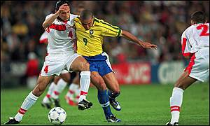Youssef Rossi tackles Brazil striker Ronaldo during the World Cup