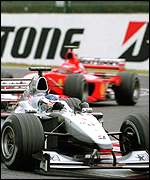 Mika Hakkinen leads Michael Schumacher in the Japanese Grand Prix