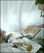 Cabin crew attend to upper class passengers