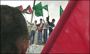The green flag of Hamas flies among the Palestinian national colours