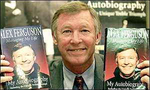 Sir Alex Ferguson with copies of his autobiography