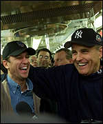 Rick Lazio (left) with Mayor Giuliani travel on the subway to the World Series