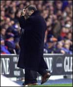 A shocked Dick Advocaat leaves the field
