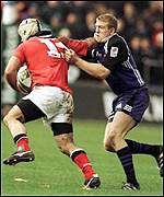 Mike Mullins grabs Munster's Mike Tindall