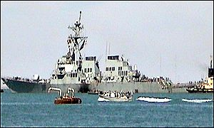 USS Cole being towed out