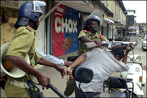 Police battle with a protester in Zanzibar