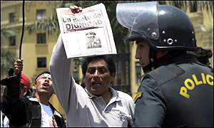 Protestor holds up picture of rebel leader Ollanta Humala
