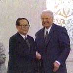 [ image: Jiang Zemin and Boris Yeltsin shake on the deal]