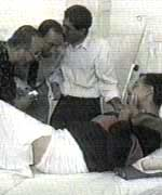 [ image: Medics attend an injured victim of the shoot-out at Luxor]