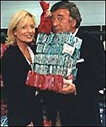 [ image: Terry Wogan and Gaby Roslin with a fraction of the cash raised last year]