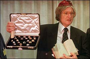 image: [ Rabbi Henry Sobel shows off a box of jewelry and a book found in the safe ]