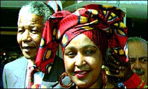 image: [ Winnie Mandela with her former husband Nelson Mandela who divorced her for adultery in 1992 ]