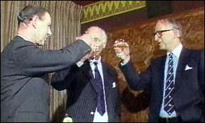 image: [ Ernest Saunders (right) toasting the Guinness takeover of Distillers in 1986 ]