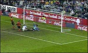 image: [ Craig Burley heads in Celtic's third goal ]
