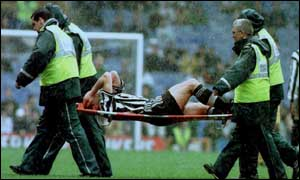 image: [ Agony for Shearer, stretchered off with ankle injury ]