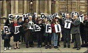 image: [ Some of the Labour rebels protest about the cuts outside the House of Commons ]
