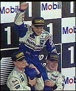 [ image: Jacques Villeneuve celebrates winning the 1997 Formula 1 championship]