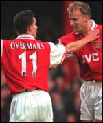 [ image: Marc Overmars celebrates his Arsenal goal with Dennis Bergkamp]