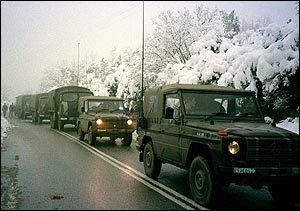 image: [ Soldiers were forced back into trucks after the weather closed in ]