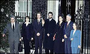 image: [ Gerry Adams (centre) and colleagues gather outside Number 10 ]