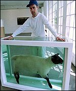 [ image: Damien Hirst with a recent exhibit]
