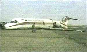 image: [ Nose down: the Biman Bangladeshi plane crashed into a paddy field ]