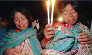 image: [ Women hold a Christmas Day vigil for the 12 children who were killed in the massacre ]