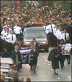 [ image: Loyalists jostled cameramen who got near the Wright cortege]
