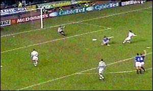 image: [ Craig Burley opens the scoring on 66 minutes ]
