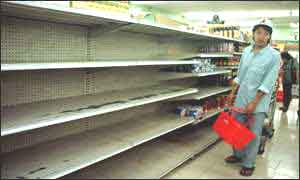 image: [ Fears of price rises have prompted shoppers to empty shelves in Jakarta ]